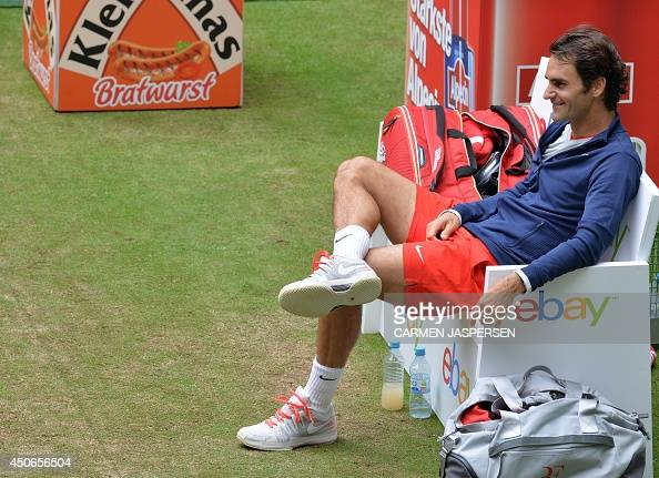 Swiss Roger Federer waits for the award ceremony to begin after winning the final match against Alejandro Falla from Columbia at the ATP Gerry Weber...