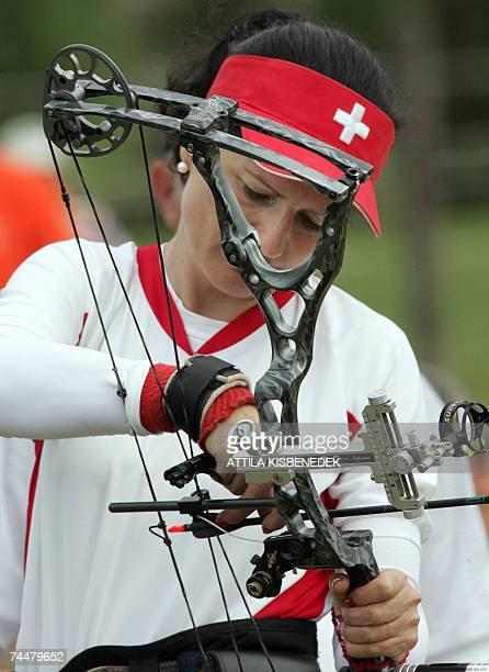 Swiss silver medalist of individual compound women category Erika Bruderer adjusts her equipment at the sport park of SopronAgfalva during the her...