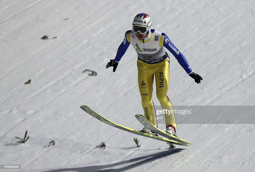 Swiss Simon Ammann lands during the first round of the FIS Ski Jumping World Cup in Vikersund, Norway on January 26, 2013.