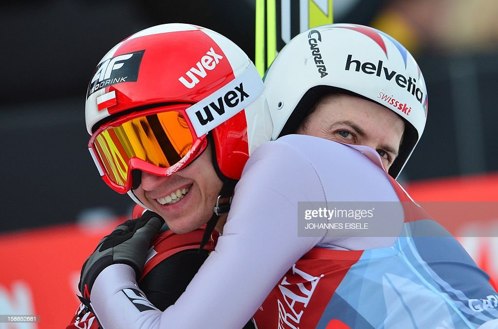 Swiss Simon Ammann (R) reacts after loosing against Poland's Kamil Stockl during the qualification of the Four-Hills-Tournament (Vierschanzentournee) in Garmisch-Partenkirchen, southern Germany on January 1, 2013. The second competition of the jumping event after Oberstdorf, takes place in Garmisch-Partenkirchen before the tournament continues in Innsbruck (Austria) and in Bischofshofen (Austria).