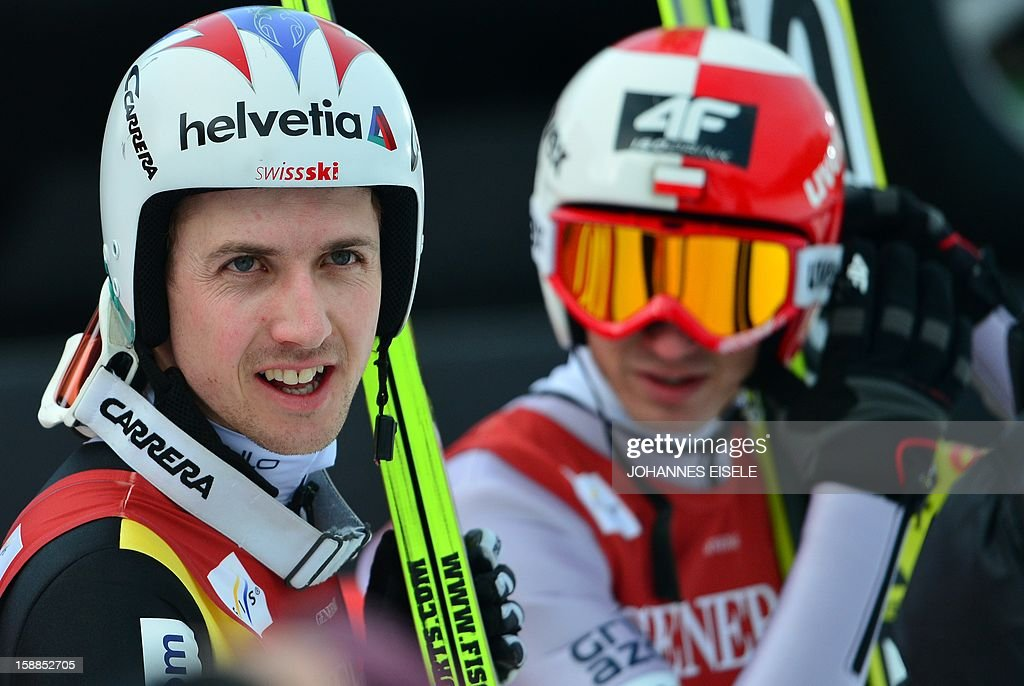 Swiss Simon Ammann (L) reacts after loosing against Poland's Kamil Stockl during the qualification of the Four-Hills-Tournament (Vierschanzentournee) in Garmisch-Partenkirchen, southern Germany on January 1, 2013. The second competition of the jumping event after Oberstdorf, takes place in Garmisch-Partenkirchen before the tournament continues in Innsbruck (Austria) and in Bischofshofen (Austria).