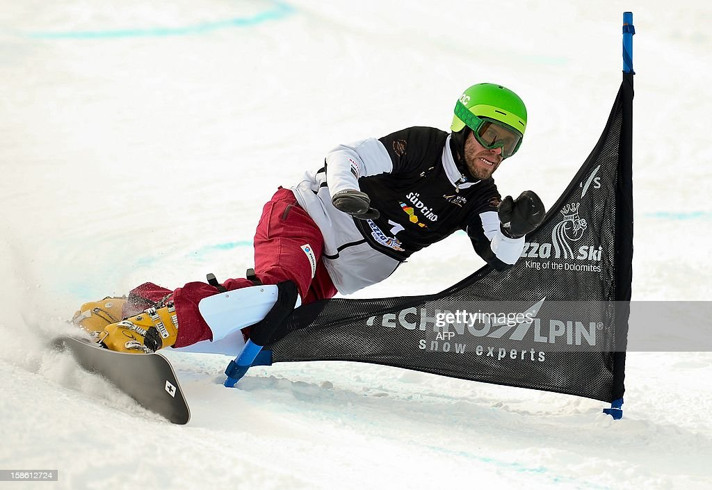 Swiss Simon Schoch clears a gate during the qualification run of the Snowboard FIS World Cup Parallel Giant Slalom race in Carezza in the Dolomites on December 21, 2012.