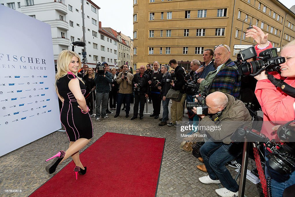Swiss singer Beatrice Egli poses for photographers at the premiere of the documentary 'Allein im Licht' ('Alone in the light') at the Babylon cinema on April 30, 2013 in Berlin, Germany.
