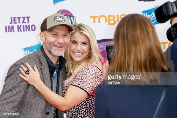 Swiss singer Beatrice Egli with a fanduring the 'My little Pony' Premiere at Zoo Palast on October 3 2017 in Berlin Germany