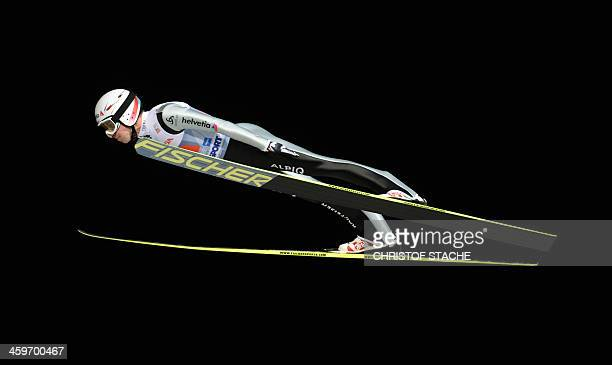Swiss ski jumper Simon Ammann competes during the first competition jump of the FourHills Ski jumping tournament in Oberstdorf southern Germany on...
