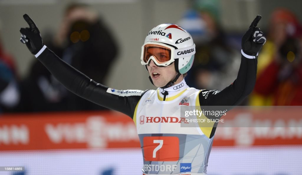 Swiss ski jumper Simon Ammann reacts after his second competition jump of the 61th edition of the Four-Hills-Tournament (Vierschanzentournee) on December 30, 2012 in Oberstdorf, southern Germany. The first competition of the jumping event will take place in Oberstdorf, before the tournament continues in Garmisch-Partenkirchen, Germany, in Innsbruck (Austria) and in Bischofshofen (Austria). Anders Jacobsen won the first competition, Gregor Schlierenzauer placed second, Germany's Severin Freund placed third. Ammann placed 6th.