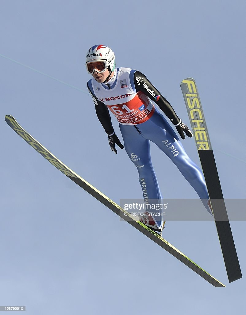 Swiss ski jumper Simon Ammann vies during a training jump of the 61th edition of the Four-Hills-Tournament (Vierschanzentournee) on December 29, 2012 in Oberstdorf, southern Germany. The first competition of the jumping event will take place in Oberstdorf, before the tournament continues in Garmisch-Partenkirchen, Germany, in Innsbruck (Austria) and in Bischofshofen (Austria).