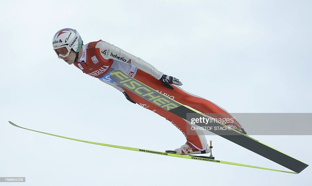 Swiss ski jumper Simon Ammann vies during a training jump of the 61th edition of the Four-Hills-Tournament (Vierschanzentournee) on January 1, 2013 in Garmisch-Partenkirchen, southern Germany. The second competition of the jumping event will take place in Garmisch-Partenkirchen, before the tournament continues in Innsbruck (Austria) and in Bischofshofen (Austria). Norway's Anders Joacobsen won the jump, Austria's ski jumper Gregor Schlierenzauer placed second and Norway's Anders Bardal placed third. AFP PHOTO/CHRISTOF STACHE