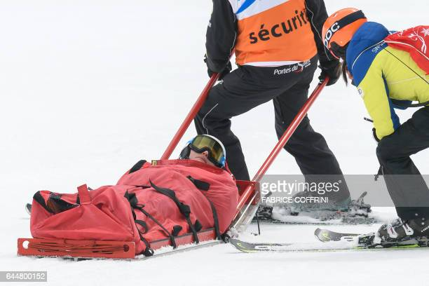 Swiss skier Denise Feierabend is evacuated on a sledge after crashing during the Super G event at the Alpine Skiing FIS World Cup Ladies Alpine...