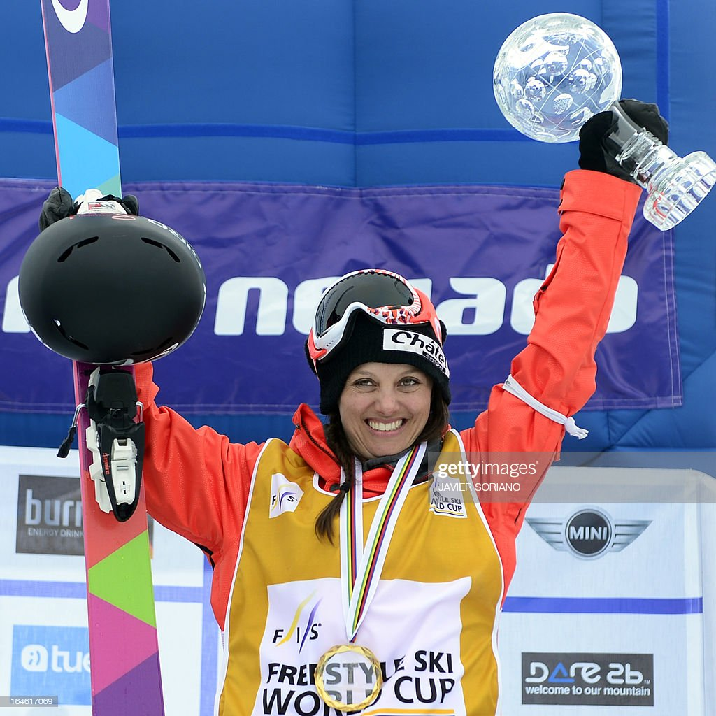 Swiss skier Virginie Faivre poses poses with her gold medal and trophy on the podium of the Ladies' Half Pipe World Cup Overall standing at the Snowboard and FreeStyle World Cup Super finals at Sierra Nevada ski resort near Granada on March 25, 2013. Swiss skier Virginie Faivre won the World Cup ahead of Canadian skier Rosalind Groenewoud and Japanese skier Ayana Onozuka.