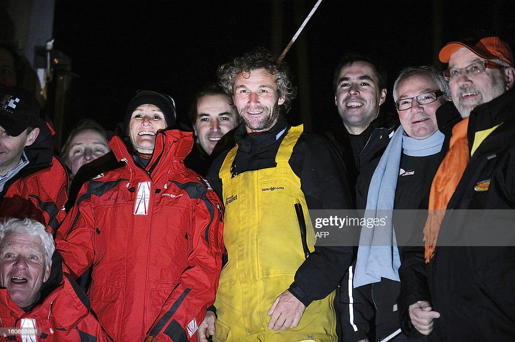 Swiss skipper Bernard Stamm (C) is welcomed by members of his team upon his arrival late on February 6, 2013 in Les Sables d'Olonne, western France, after ending the 7th edition of the Vendee Globe solo round-the-world race. Stamm was disqualified on January 2, 2013, after receiving uncalled for assistance after his generator packed up but was later allowed to race on following a successful appeal to the race jury.