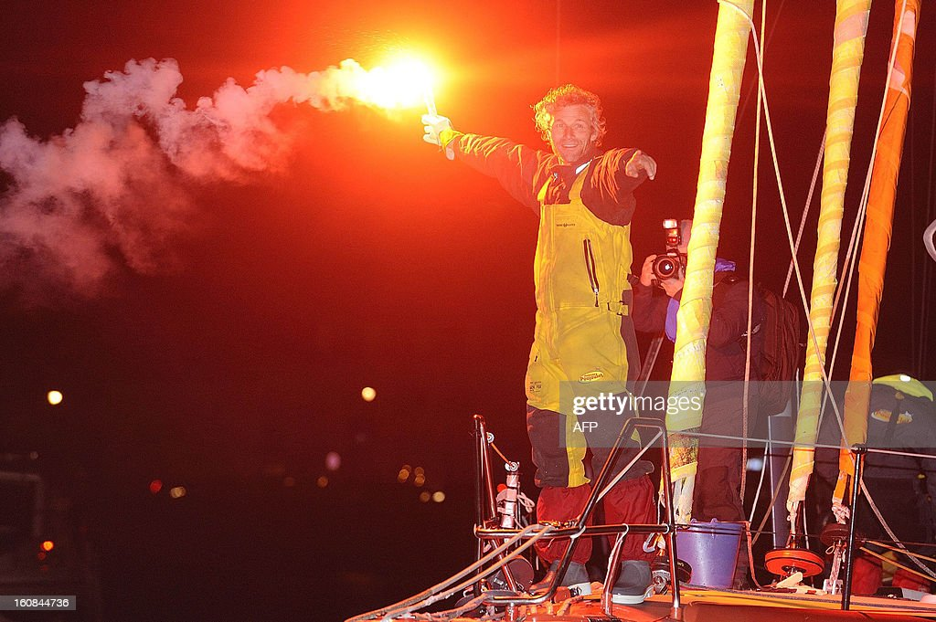 Swiss skipper Bernard Stamm stands on his monohull 'Cheminees Poujoulat' as he finished the 7th edition of the Vendee Globe solo round-the-world race on February 6, 2013 upon arrival, in Les Sables d'Olonne, western France. Stamm was disqualified on January 2 after receiving uncalled for assistance after his generator packed up but was later allowed to race on following a successful appeal to the race jury. AFP PHOTO JEAN-SEBASTIEN EVRARD