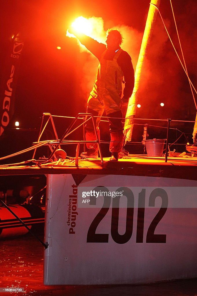 Swiss skipper Bernard Stamm stands on his monohull 'Cheminees Poujoulat' as he finished the 7th edition of the Vendee Globe solo round-the-world race on February 6, 2013 upon arrival, in Les Sables d'Olonne, western France. Stamm was disqualified on January 2 after receiving uncalled for assistance after his generator packed up but was later allowed to race on following a successful appeal to the race jury.