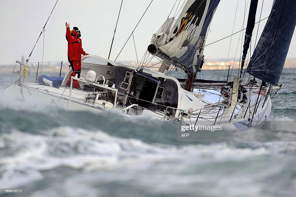 Swiss skipper Dominique Wavre celebrates on his monohull 'Mirabaud' as he finished seventh in the 7th edition of the Vendee Globe solo roundtheworld...