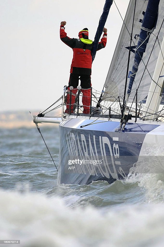 Swiss skipper Dominique Wavre celebrates on his monohull 'Mirabaud' as he finished seventh in the 7th edition of the Vendee Globe solo round-the-world race on February 8, 2013 in Les Sables d'Olonne, western France.