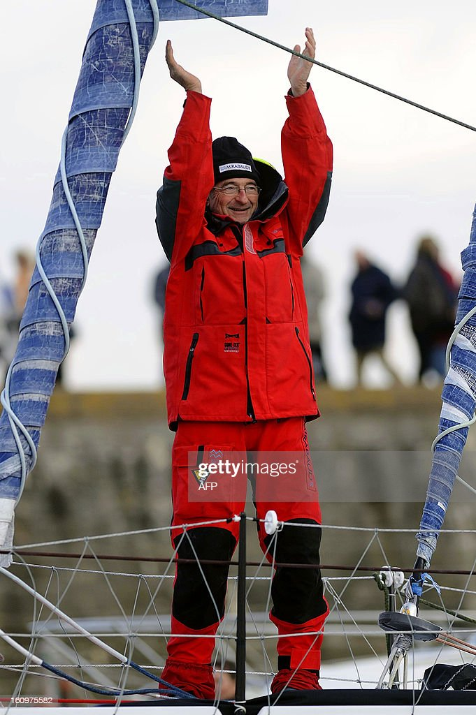 Swiss skipper Dominique Wavre celebrates on his monohull 'Mirabaud' as he finished seventh of the 7th edition of the Vendee Globe solo round-the-world race on February 08, 2013 in Les Sables d'Olonne, western France.