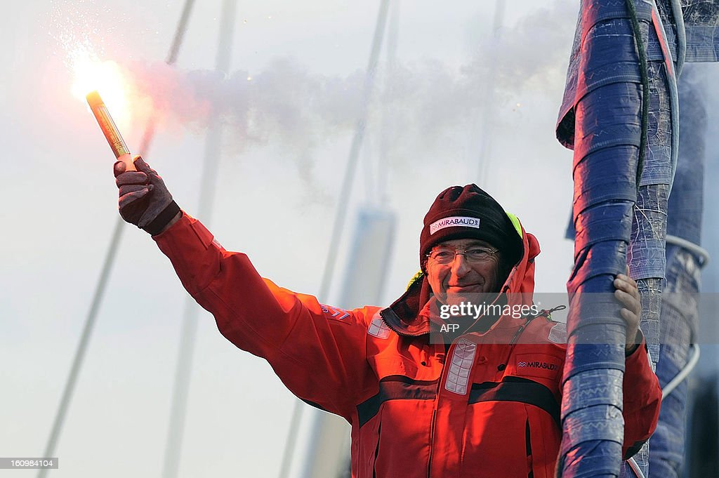 Swiss skipper Dominique Wavre celebrates on his monohull 'Mirabaud' as he arrives at Les Sables-d'Olonne harbour after placed seventh of the 7th edition of the Vendee Globe solo round-the-world race on February 08, 2013.