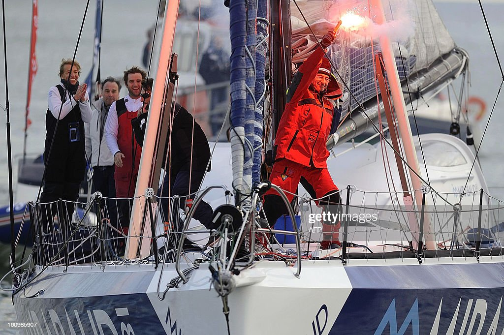 Swiss skipper Dominique Wavre celebrates on his monohull 'Mirabaud' as he arrives at Les Sables-d'Olonne harbour after placed seventh of the 7th edition of the Vendee Globe solo round-the-world race on February 08, 2013. AFP PHOTO JEAN-SEBASTIEN EVRARD