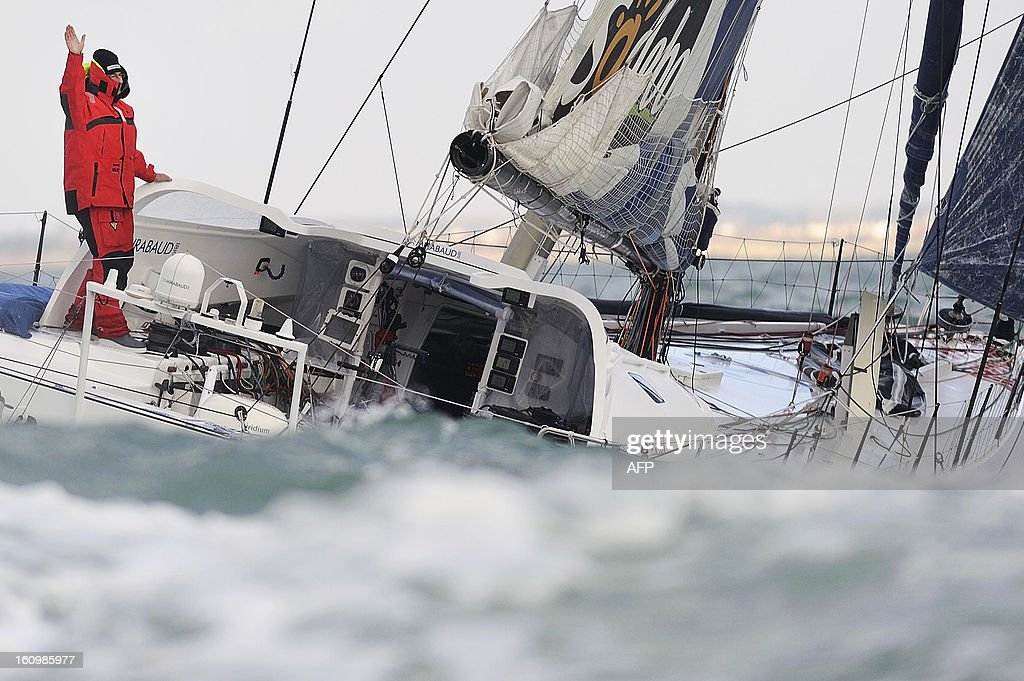 Swiss skipper Dominique Wavre celebrates on his monohull 'Mirabaud' as he finished seventh of the 7th edition of the Vendee Globe solo round-the-world race on February 8, 2013 in Les Sables d'Olonne, western France. AFP PHOTO JEAN-SEBASTIEN EVRARD