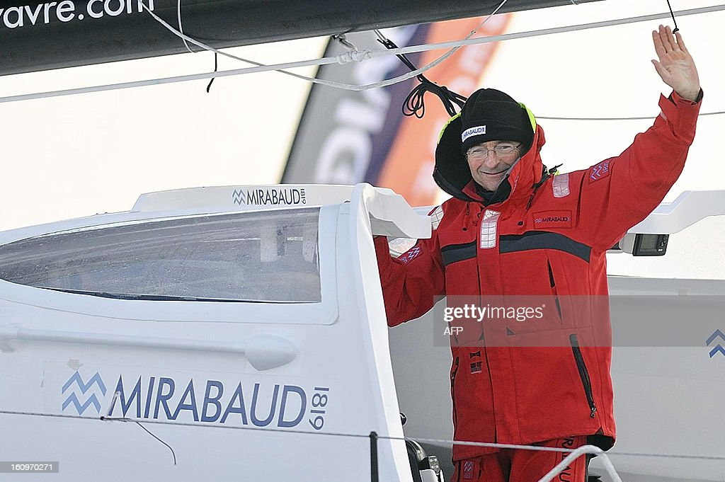 Swiss skipper Dominique Wavre celebrates on his monohull 'Mirabaud' after finishing seventh in the 7th edition of the Vendee Globe solo round-the-world race on February 8, 2013 in Les Sables d'Olonne, in western France. AFP PHOTO JEAN-SEBASTIEN EVRARD