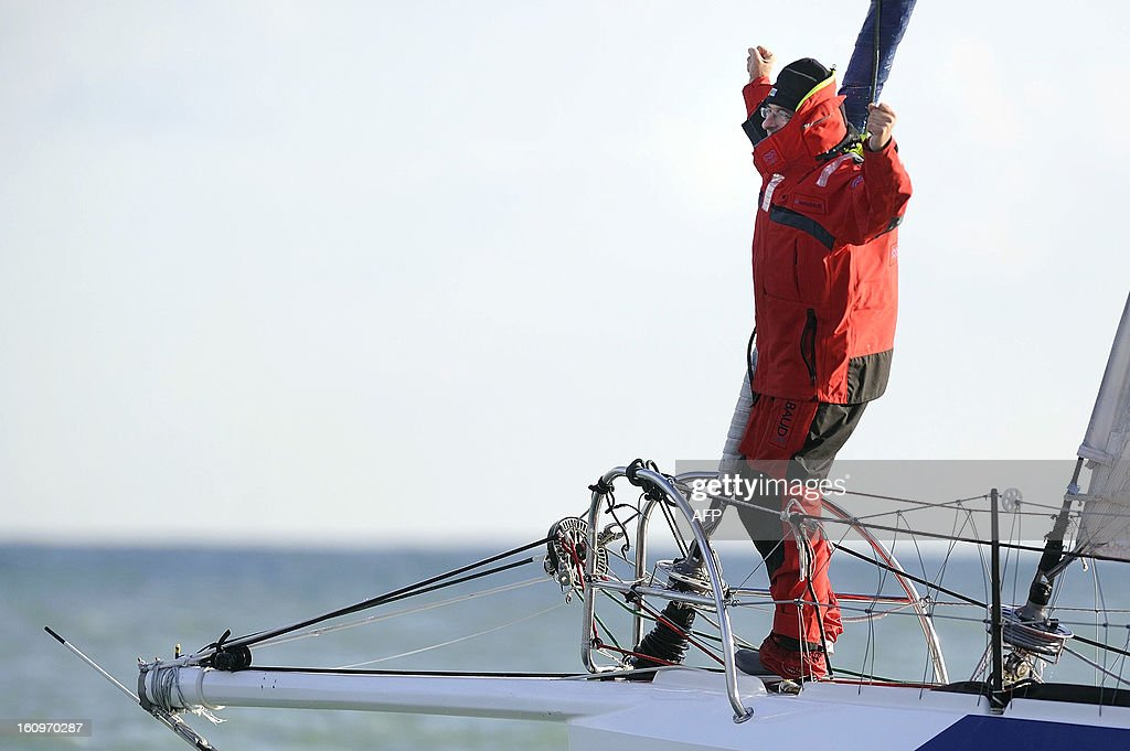 Swiss skipper Dominique Wavre celebrates on his monohull 'Mirabaud' after finishing seventh in the 7th edition of the Vendee Globe solo round-the-world race on February 8, 2013 in Les Sables d'Olonne, in western France.