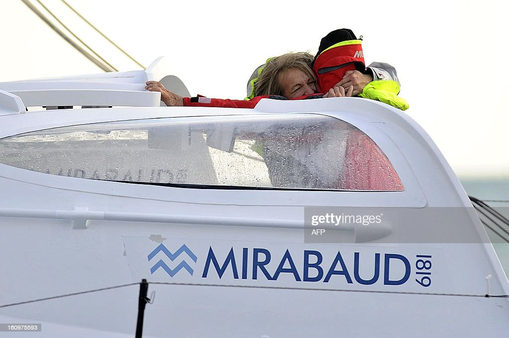 Swiss skipper Dominique Wavre (R) celebrates with his girlfriend Michele Paret on his monohull 'Mirabaud' as he finished seventh of the 7th edition of the Vendee Globe solo round-the-world race on February 08, 2013 in Les Sables d'Olonne, western France. AFP PHOTO JEAN-SEBASTIEN EVRARD