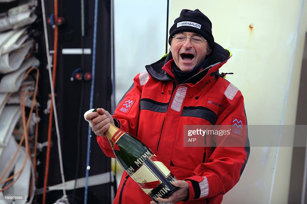 Swiss skipper Dominique Wavre is about to spray champagne on his monohull 'Mirabaud' as he finished seventh of the 7th edition of the Vendee Globe solo round-the-world race on February 08, 2013 in Les Sables d'Olonne, western France. AFP PHOTO JEAN-SEBASTIEN EVRARD