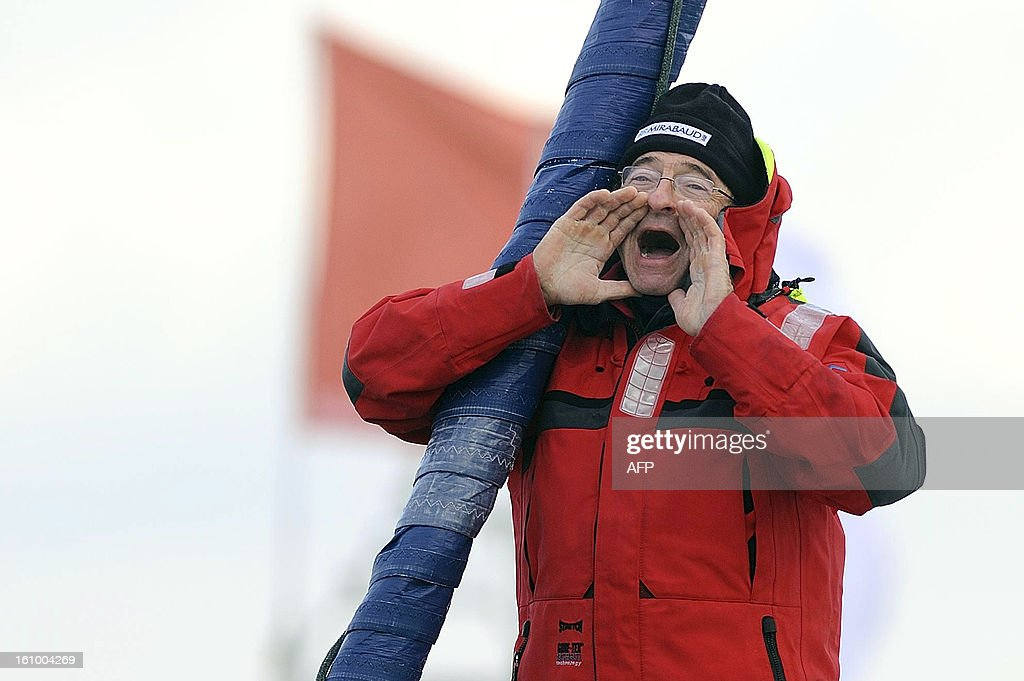 Swiss skipper Dominique Wavre shouts as he arrives at Les Sables-d'Olonne harbour after placed seventh of the 7th edition of the Vendee Globe solo round-the-world race on February 08, 2013.