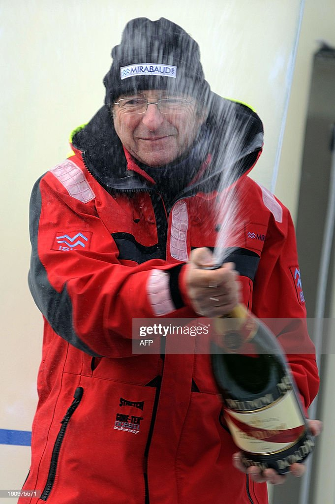 Swiss skipper Dominique Wavre sprays champagne on his monohull 'Mirabaud' as he finished seventh of the 7th edition of the Vendee Globe solo round-the-world race on February 08, 2013 in Les Sables d'Olonne, western France.