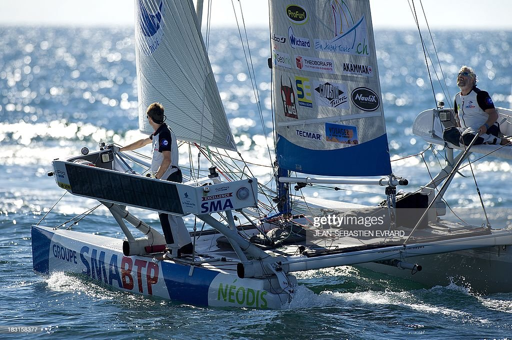 Swiss skipper Yvan Bourgnon and French Vincent Beauvarlet depart on a round the world trip on a catamaran on October 5, 2013 from Les Sables d'Olonne. The pair plan to take 11 months to cover the trip on a 6.3metre catamaran, the first to attempt such a trip. EVRARD