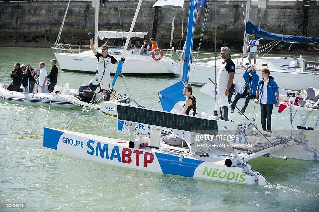 Swiss skipper Yvan Bourgnon (R) and French Vincent Beauvarlet (L) take the start for one-year trip around the world without assistance on their 6,40m multi hull 'Defi SMA'on October 5, 2013 in Les Sables d'Olonne, western France.