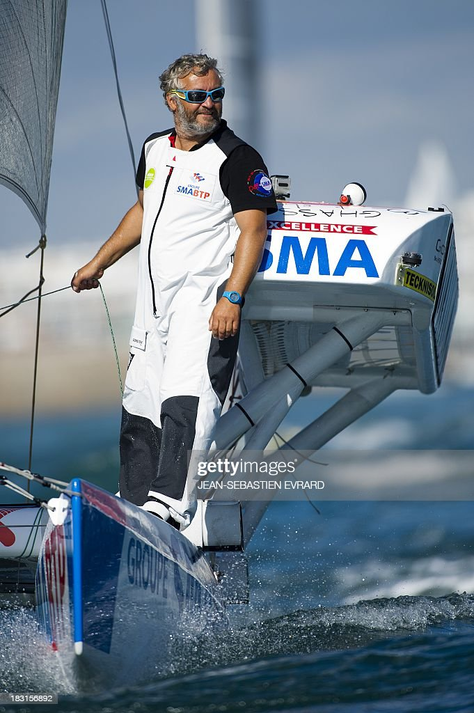 Swiss skipper Yvan Bourgnon is seen as he takes the start with French Vincent Beauvarlet of a one-year trip around the world without assistance on their 6,40m multi hull 'Défi SMA'on october 5, 2013 in Les Sables d'Olonne, western France.