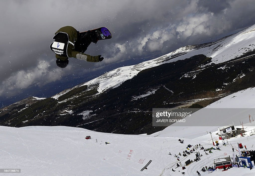 Swiss snowboarder David Habluetzel competes in the Men's Half-Pipe final race at the Snowboard and FreeStyle World Cup Super finals at Sierra Nevada ski resort near Granada on March 27, 2013. David Habluetzel took fifth place of the event.
