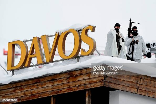 Swiss special police forces take position next to a sign reading Davos at the opening of the World Economic Forum annual meeting in Davos on January...