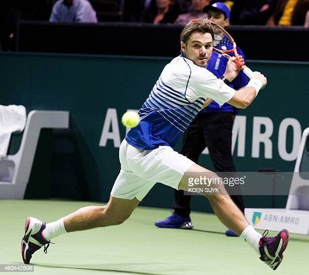 Swiss Stan Wawrinka retunrs the ball against Canadian Milos Raonic during the semi final match of the ABN AMRO World Tennis Tournament in Rotterdam...