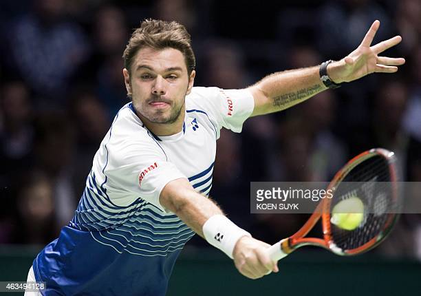 Swiss Stan Wawrinka returns the ball against Czech Tomas Berdych on February 15 2015 during the final at the ABN AMRO Tennis Tournament in Ahoy...