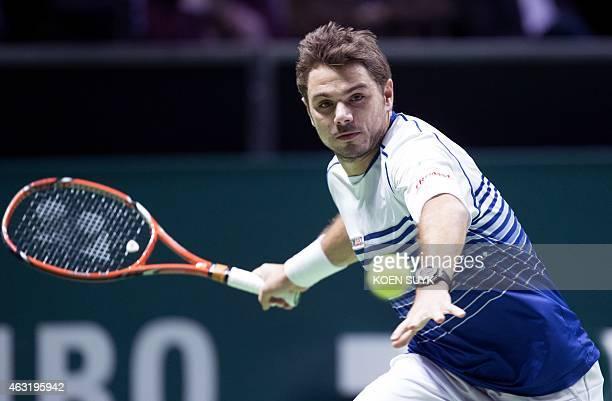 Swiss Stan Wawrinka returns the ball to Dutch Jesse Huta Galung during their first round match of the ABN AMRO World Tennis Tournament in Rotterdam...