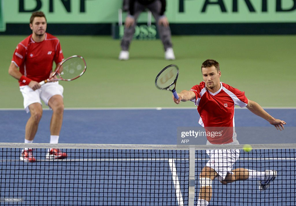 Swiss Stanislas Wawrinka (L) and Marco Chiudinelli play against Czech Tomas Berdych and Lukas Rosol during a Davis Cup World Group first round tennis match between Switzerland and title owner the Czech Republic on February 2, 2013 in Geneva.