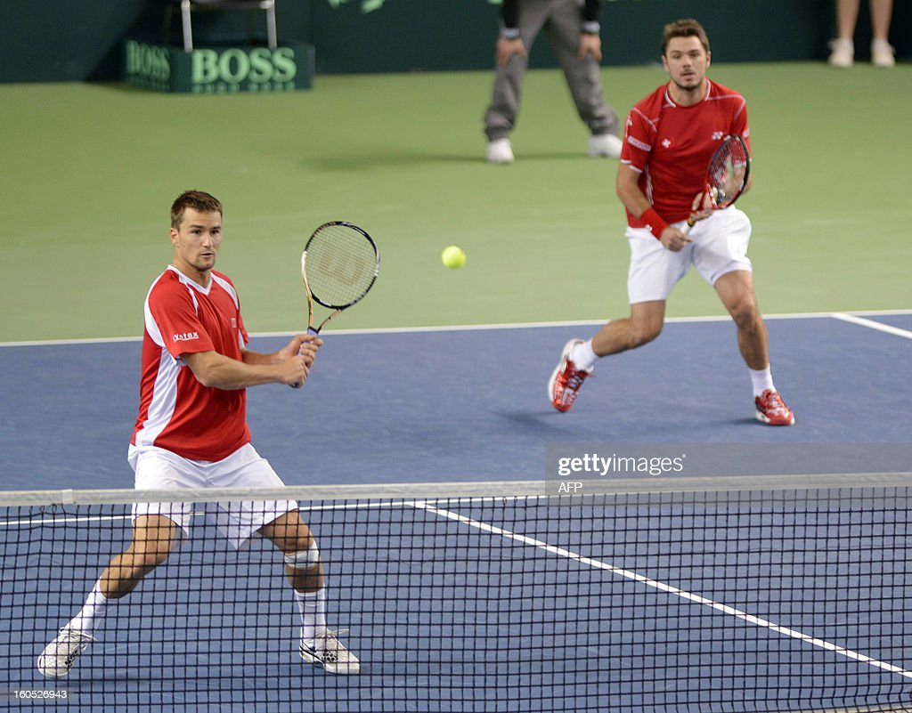 Swiss Stanislas Wawrinka (R) and Marco Chiudinelli play against Czech Tomas Berdych and Lukas Rosol during a Davis Cup World Group first round tennis match between Switzerland and title owner the Czech Republic on February 2, 2013 in Geneva.
