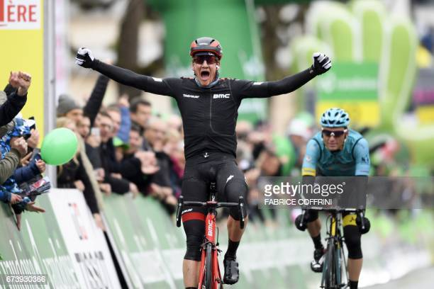 Swiss Stefan Kueng celebrates after winning the second stage of the 'Tour de Romandie' UCI protour cycling race a 1365 km ride from Champery to Bulle...