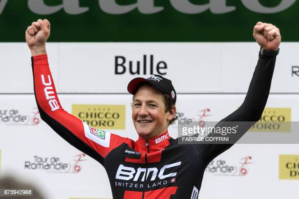 Swiss Stefan Kueng celebrates his victory on the podium after the second stage of Tour de Romandie UCI protour cycling race a 1365 km ride from...