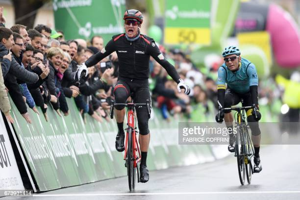 Swiss Stefan Kueng sprints to win ahead of Ukrainian Andriy Grivko the second stage of the 'Tour de Romandie' UCI protour cycling race a 1365 km ride...