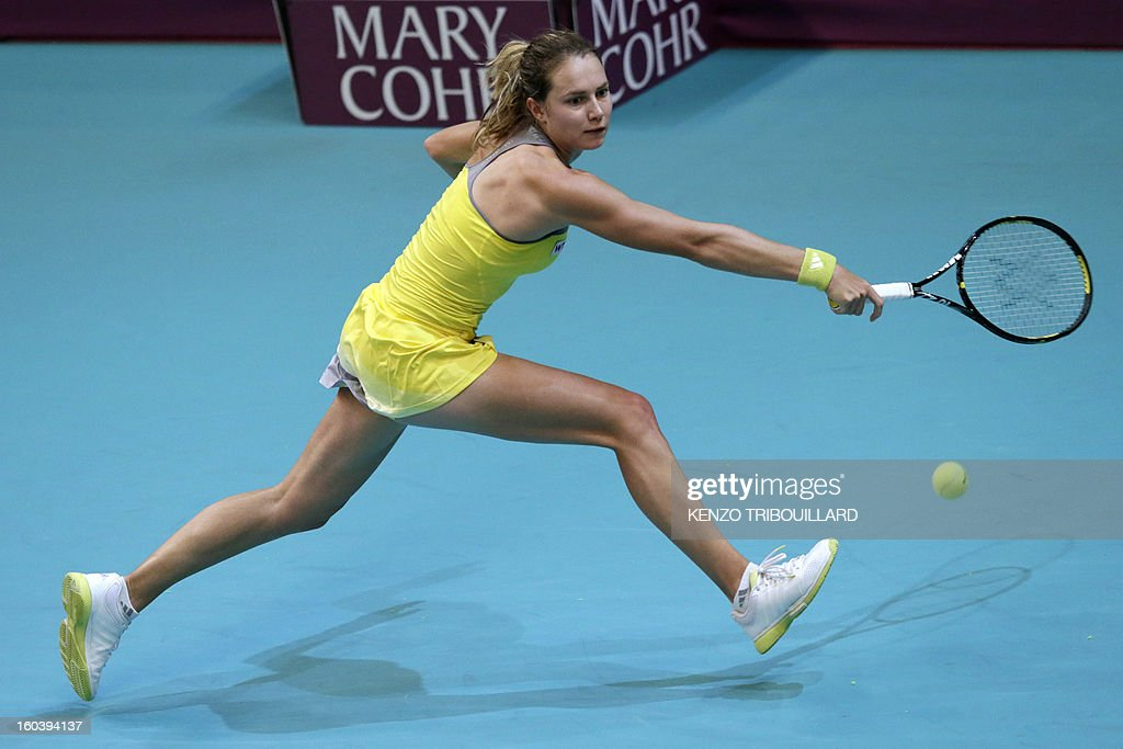 Swiss Stefanie Voegele returns the ball to Czech Republic's Petra Kvitova during their tennis match at the 21st edition of the Paris WTA Open on January 30, 2013.