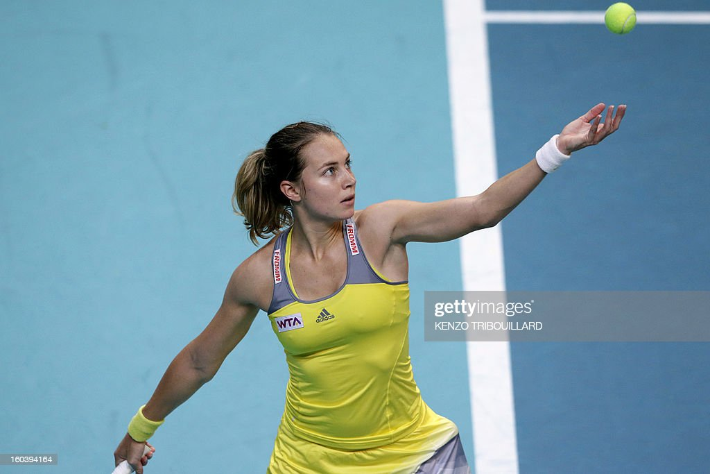 Swiss Stefanie Voegele returns the ball to Czech Republic's Petra Kvitova during their tennis match at the 21st edition of the Paris WTA Open on January 30, 2013. AFP PHOTO / KENZO TRIBOUILLARD
