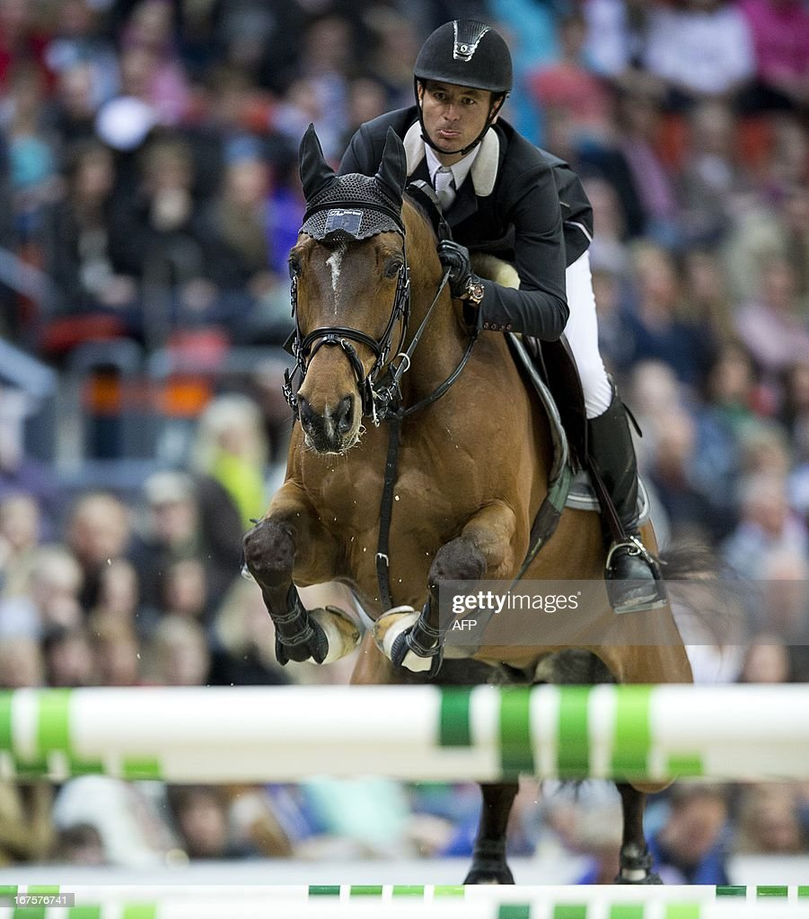 Swiss Steve Guerdat, rides his horse Nino des Buissonnets to win Rolex FEI World Cup Jumping final on April 26, 2013 during the Gothenburg Horse Show in Scandinavium. AFP PHOTO / ADAM IHSE / SCANPIX SWEDEN/SWEDEN OUT