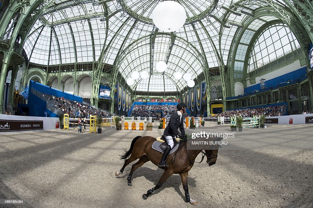 Swiss <a gi-track='captionPersonalityLinkClicked' href=/galleries/search?phrase=Steve+Guerdat&family=editorial&specificpeople=2304249 ng-click='$event.stopPropagation()'>Steve Guerdat</a> riding Corbinian, competes during the International Jumping Competition 'Prix du Grand Palais' on April 10, 2015, at the Grand Palais in Paris.