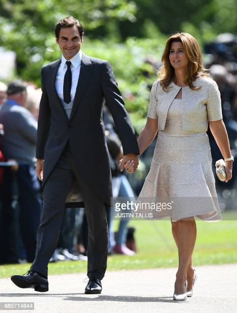 Swiss tennis player Roger Federer and his wife Mirka attend the wedding of Pippa Middleton and James Matthews at St Mark's Church in Englefield west...