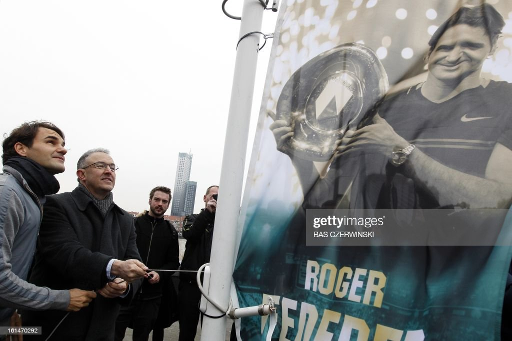 Swiss tennis player Roger Federer (L) and Rotterdam Mayor Ahmed Aboutaleb attend on February 11, 2013 a promotional event for the Rotterdam World Tennis in Rotterdam, which ends on February 17. CZERWINSKI - netherlands out -