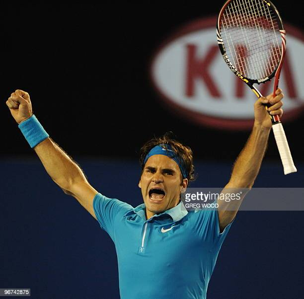 Swiss tennis player Roger Federer celebrates after victory in his men's singles final match against British opponent Andy Murray at the Australian...