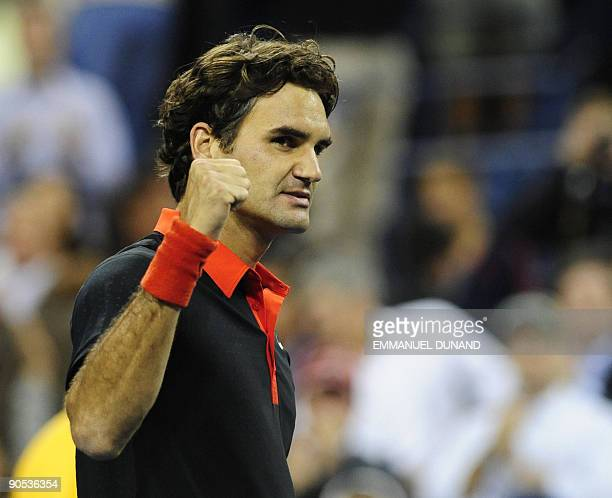Swiss tennis player Roger Federer celebrates after winning against Swedish player Robin Soderling during their quarterfinals match of the 2009 US...